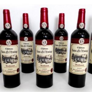 Multiplying Wine Bottles Red by Tora Magic (4949-G1)